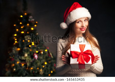 christmas, x-mas, valentine's day, celebration concept - smiling woman with gift box - stock photo