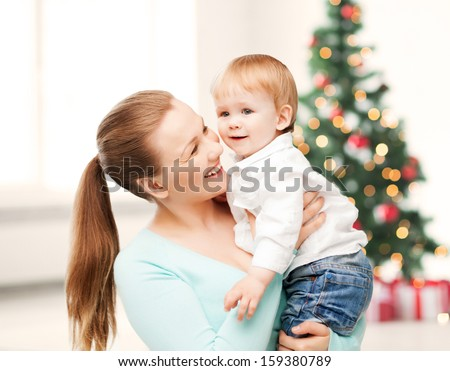 christmas, x-mas, winter, family, people, happiness concept - happy mother with adorable baby - stock photo