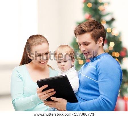 christmas, x-mas, winter, family, people, happiness, modern technology concept - happy parents and adorable baby with tablet pc - stock photo