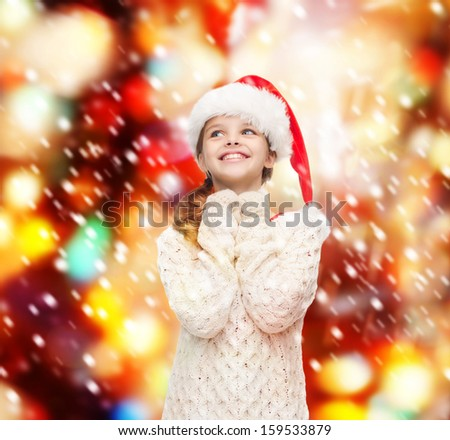 christmas, x-mas, winter, happiness concept - dreaming girl in santa helper hat - stock photo