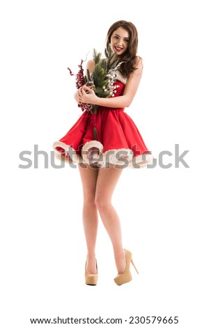 Christmas, x-mas, winter, happiness concept - smiling woman in Santa Claus dress with Christmas decorations bouquet - stock photo