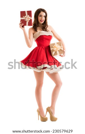 Christmas, x-mas, winter, happiness concept - smiling woman in Santa Claus dress with gift boxes - stock photo