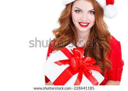 christmas, x-mas, winter, happiness concept - smiling woman in santa helper hat with many gift boxes. picture of cheerful santa helper girl with gift box isolated on white. studio shot - stock photo