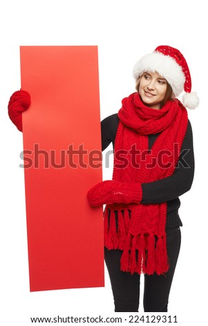 Christmas, X-mas, Xmas sale, shopping concept - Smiling woman wearing Santa hat with red sale sign, looking at blank copy space at banner - stock photo