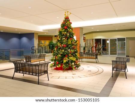 Christmas, xmas tree in the lobby. Interior design. - stock photo