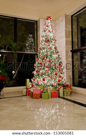 Christmas, xmas tree in the lobby. Interior design. Vertical.