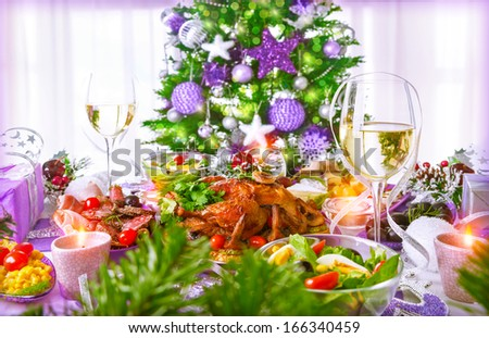 Christmastime dinner with backed chicken, various of dish and traditional Christmas drink, champagne, New Year eve concept  - stock photo
