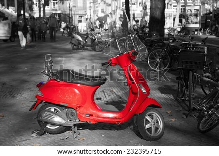 chroma key picture of a red scooter in in the city with a black and white surrounding - stock photo