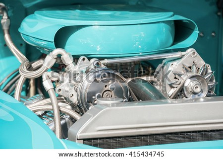 chrome and turquoise engine bay on a high performance vehicle - stock photo