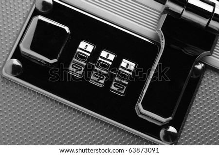 chrome combination lock of aluminium box, ideal of security concept - stock photo