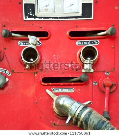 Chrome dials and valves on an old red fire truck [Firefighters c - stock photo