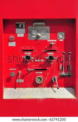 Chrome dials and valves on an old red fire truck Firefighters car equipment - stock photo