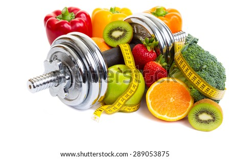 Chrome dumbbells surrounded with healthy fruits and vegetables studio shot on a white background with shadows. - stock photo