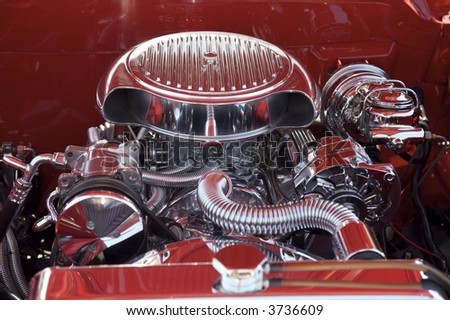 Chrome Engine in Red Car - stock photo