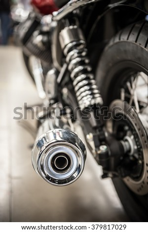 Chrome exhaust pipe of a beautiful motorcycle - stock photo