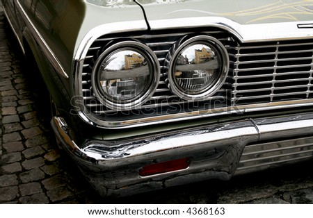 chrome front of a classic 50s car - stock photo