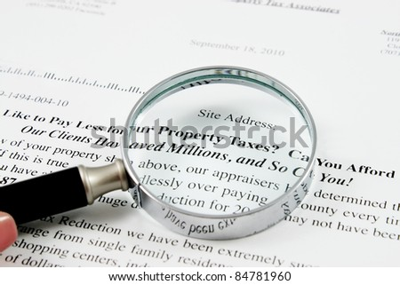 chrome Magnifying Glass and paper from tax associates