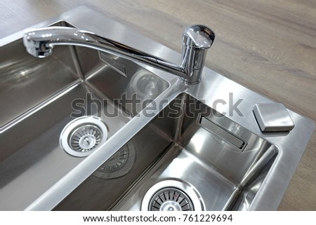 Chrome Mixer Taps And Stainless Steel Sink Two Bowls On Wooden Worktop