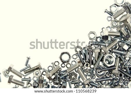 Chrome nuts and bolts closeup, copy space - stock photo