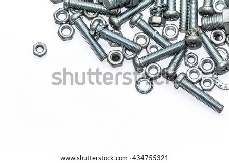 Chrome nuts and bolts closeup on plain background