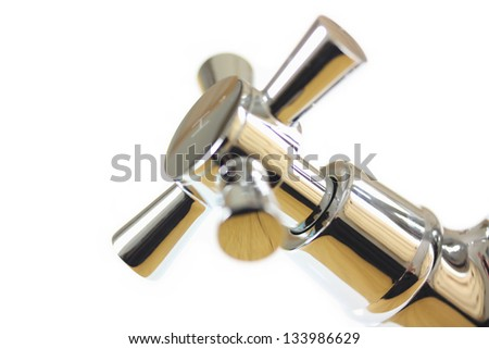Chrome tap abstract on white background