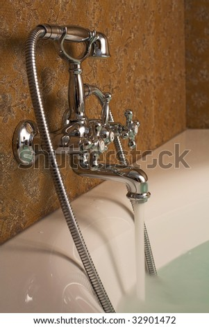 chrome tap with water flowing - stock photo