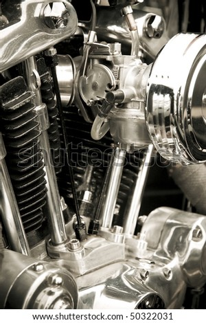 chromed detail and cyclinders of a powerful motorcycle engine