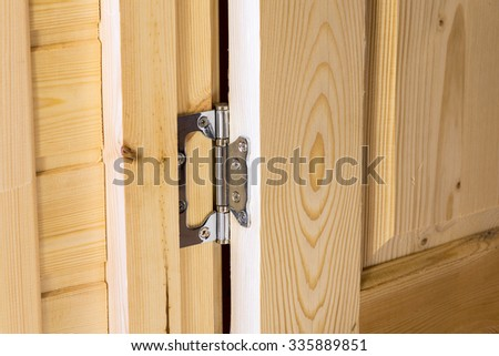Chromed door hinge  - stock photo