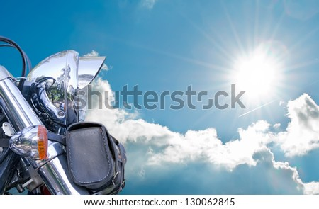 chromed motorcycle under a blue sky