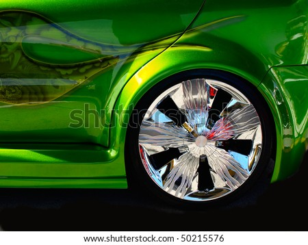 chromed wheel on a tuned car - stock photo