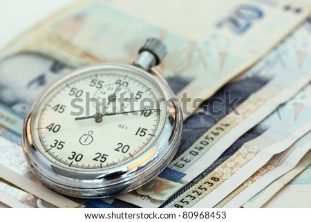 Chronometer and Bulgarian currency close up, shallow dof - stock photo
