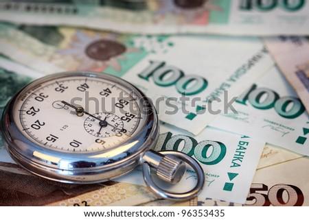Chronometer and Bulgarian leva  bills, close up , shallow dof - stock photo