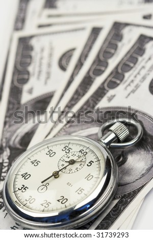 Chronometer and dollar bills close up - stock photo