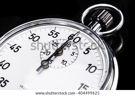 Chronometer isolated on black background with a little reflexion - stock photo