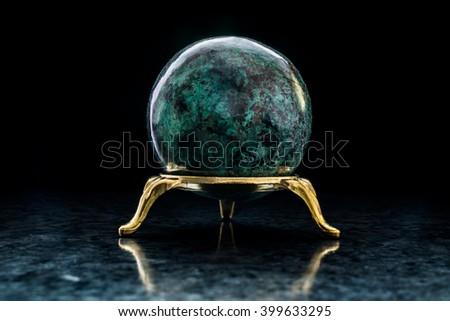 Chrysocolla ball on stand - stock photo