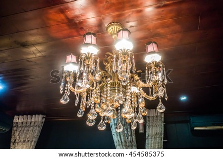 Chrystal chandelier close-up. Glamour background, dark tone