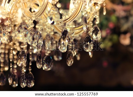 Chrystal chandelier close-up. Glamour background with copy space - stock photo