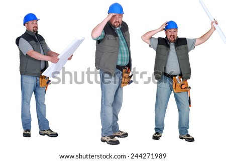 Chubby builder holding plans - stock photo