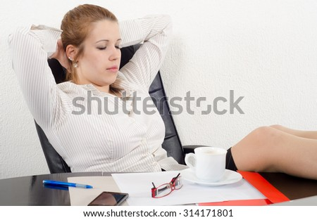 Chubby business woman resting during the job in her office. - stock photo