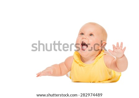 Chubby laughing baby laying on the belly alone