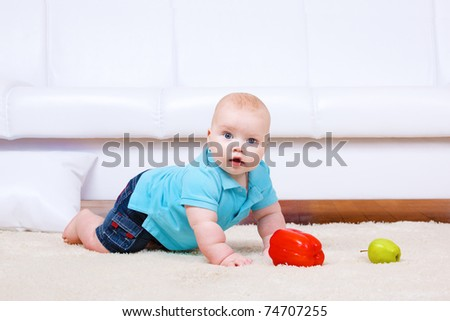 Chubby toddler crawling in the living room