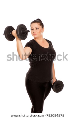 Chubby woman posing with weights in fitness clothing on white background