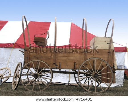 Chuck wagon parked in front of tent - stock photo