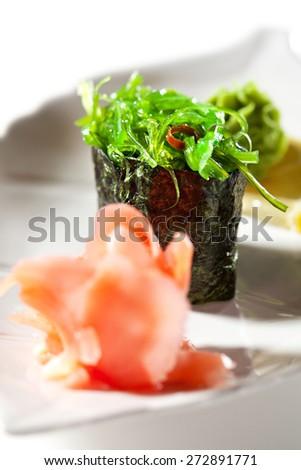 Chuka Seaweed  Gunkan Sushi Garnished with Ginger and Wasabi - stock photo
