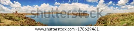 Chullpas of Sillustani and a lake, Peru, South America - stock photo
