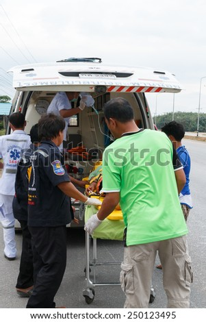 Chumpon, Thailand January 3 :Woman who accident by car was rescue by doctor and rescue on site of accident. Thailand on January 3, 2015 - stock photo