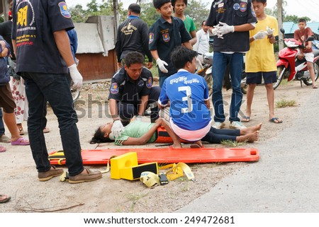 Chumpon, Thailand January 3 :Woman who accident by car was rescue by rescue on site of accident. Thailand on January 3, 2015 - stock photo