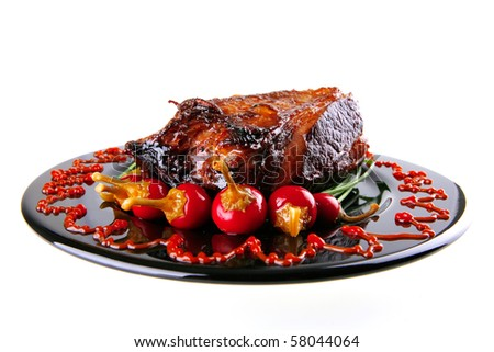 chunk of beef meat served on black - stock photo
