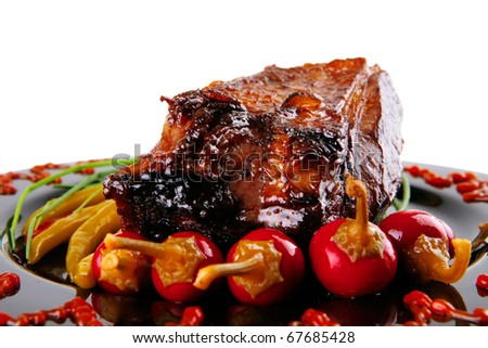 chunk of beef meat served on black