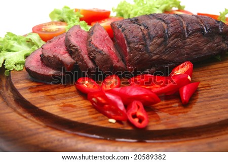 chunk of roast meat, and slices - stock photo